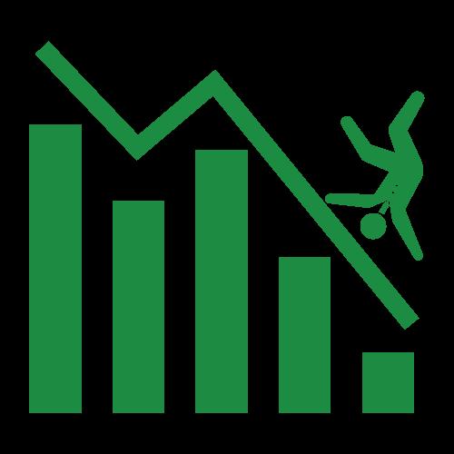 業績グラフの上を滑り落ちるビジネスマン